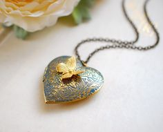 Heart Locket Necklace. Butterfly Locket Necklace, Slate Dusky Blue Verdigris Patina Large Golden Brass Locket Necklace, Valentine's Day Gift by LeChaim on Etsy https://www.etsy.com/listing/123602969/heart-locket-necklace-butterfly-locket