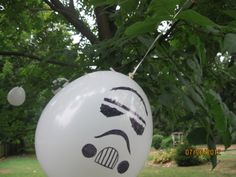 Lego star wars party. Jedi training games. For part of lightsaber training, kids hit stormtooper balloons I tied to trees. Kids loved it if they popped it against the tree. To make the stormtrooper face, I blew up plain white balloons and used a pumpkin carving template I found online.