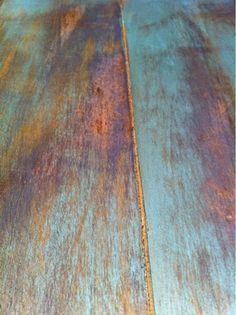 DIY: Layered Dry Brushed Finish - dry brushing layers of orange and turquoise paint, followed by a layer of stain - via The Quaint Cottage