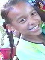 """Missing: TIONDA Z. BRADLEY. 07/06/2001; DOB: January 20, 1991.   Place of Birth: Chicago, IL.   Height: 4'2"""".   Weight: 70lbs.   Hair: Brown.   Eyes: Brown.   Sex: Female.   Race: Black. Disappearance: She has a burn scar on her left forearm about the size of a quarter. Tionda was last seen wearing green ponytail holders in her hair, and at the time of her disappearance, she had a scrape on her left calf. She is described as being shy with strangers, and loves to run track and dance."""