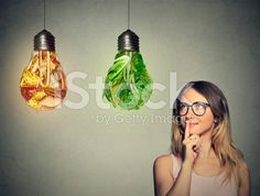 woman looking at junk food green vegetables shaped lightbulb royalty-free stock photo