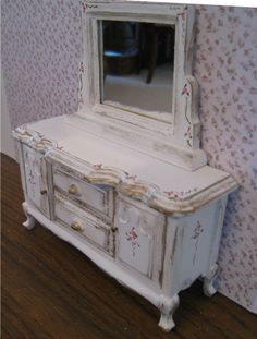 Shabby Chic  mirrored ,  distressed white with rose bouquets,  Twelfth scale dollhouse miniature. $18.00, via Etsy.
