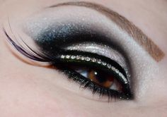 Striking black and white shimmering eye make-up with crystal lined lashes.