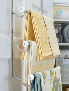 Repurpose a towel rack to keep table linens easy to sort through and wrinkle free: