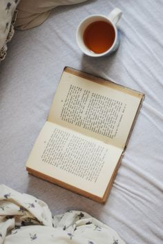 Laying in bed with a good book and tea.