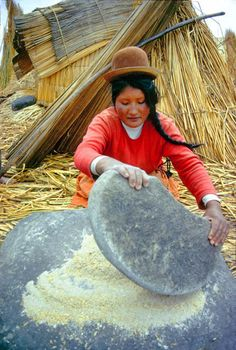 An Uro-Aymara indian grinds barley between two stones. Reeds are the stuff of her life. She sleeps on a reed mat, in a reed hut, and on a reed Floating. We Are The World, People Around The World, Around The Worlds, Andes Mountains, South Of The Border, Equador, Peru Travel, Inca, Lake Titicaca
