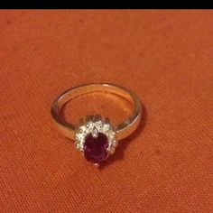 Amethyst ring size 7 1/4 Silver plat amethyst ring size 7 1/4. Brand-new with tag. Any questions please message me. I bought it  a jewelry fair Jewelry Rings