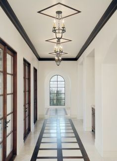 This long hallway gets great lighting, a great view, and an aesthetic balance with each dark trim.