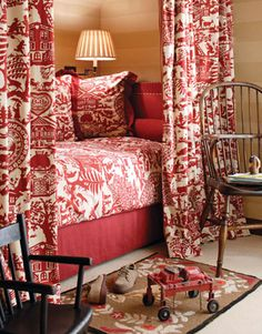 Always loved this. The red and white fabric is Pierre Frey's and it is piped in a red and white cord!