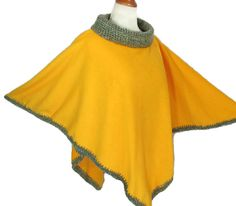 Womens Fleece Poncho with Crochet Draped Neck and by knitwhats A fun and feminine anti-pill fleece poncho with a beautiful crochet draped neck and fully crochet trim around the poncho. This wonderful gold color fleece will be a wonderful addition to your wardrobe. You can wear it with so many colors!  Grab it to drive in the car, walk around the mall, just about anything you want to do. Perfect accessory to slip on over your denim to your best slacks.  A great poncho to wear for the changin