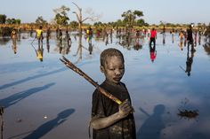 Children fleeing deadly conflicts in Sudan and South Sudan share a singular pursuit: catching mudfish to pay for their schooling. UNHCR/ A. McConnell.