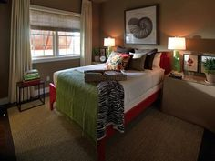 The HGTV Green Home 2009 guest bedroom features a bright red and green color scheme and subtle seashell theme. See it on HGTV.com.