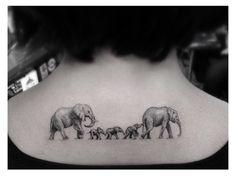 Elephant Family tattoo on back of neck ~ Dr. Woo tattooist, L.A