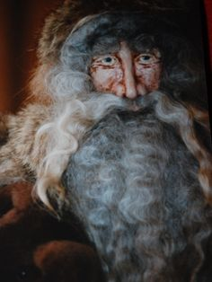 OOAK Victorian Santa with hand sculpted papier mache face.  I made this one in 1997. He is more of a woodland Santa TK