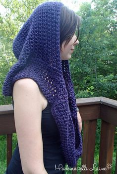 This handknit hooded infinity scarf is handknited with a purple yarn made of wool for warmth and softness and nylon for resistance. It will look great with a nice coat for winter.