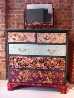 I love this. Wallpapered dresser. So interesting and different.