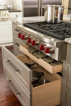Custom drawer unit hides extra rollout shelf for pot lids! Efficiency is key when planning a kitchen reno! aCLeaRdesign.blogspot.com