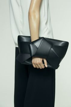 Musubi Clutch, Black leather. #acneclothing