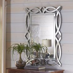 Revive your reflective style with the unique design of our wall mirror. Framed with a mirrored scrollwork design, it makes a bold statement in any space from the bathroom to the entryway.