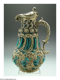 AN AMERICAN GILT SILVER AND GLASS WINE EWER, Mark of Whiting, Providence, Rhode Island, c.1890