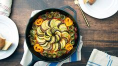 Recipe with video instructions: Yes, you can make this classic, colorful French dish — and it's even easier than you thought. Ingredients: 2 small eggplants, cut into rounds, 1 orange bell pepper, cut into rounds, 2 small zucchinis, cut into 1/4-inch rounds and ribbons, 2 small yellow squash, cut into 1/4-inch rounds and ribbons, Olive oil, 1/2 yellow onion, long slices, 2 cloves garlic, finely chopped, 1 (28-ounce) can crushed tomatoes,1/4 cup of liquid removed, Salt ...