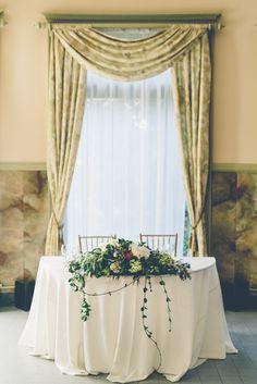 Lush Green Arrangement on Sweetheart Table   Ryan and Gina Photography https://www.theknot.com/marketplace/gina-and-ryan-photography-burbank-ca-767679   JA Drop Productions   La Bella Dia Weddings   Tea Rose Garden
