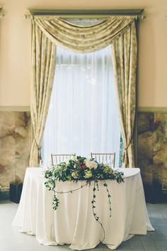 Lush Green Arrangement on Sweetheart Table | La Bella Dia Weddings | Tea Rose Gardens | Gina & Ryan Photography https://www.theknot.com/marketplace/gina-and-ryan-photography-burbank-ca-767679