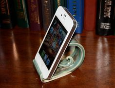 Handmade iPhone display stand dock and card holder pottery aqua curl wave thin. $15.00, via Etsy.