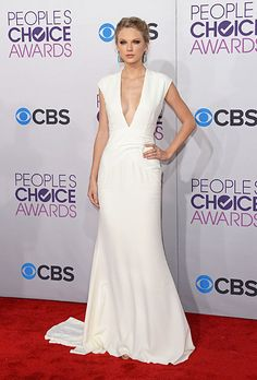 Brides.com: The Most Wedding-Worthy Red Carpet Dresses. Taylor Swift at the 2013 People's Choice Awards. Newly-single Swift stuns in this plunging Ralph Lauren gown. We love how she pairs the dress with turquoise drop earrings, smoky eye makeup and a simple updo. The ensemble is perfect for a sexy wedding day look.  Browse v-neck wedding dresses.