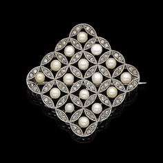 A pearl and diamond plaque brooch. The openwork square plaque, set throughout with 3.8mm pearls, each centrally-set within a rose-cut diamond circular surround, millegrain-set throughout, pearls untested, length 4.0cm