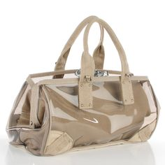 This is an authentic PRADA Canvas Mistolino Vinyl Crystal Cluster Tote in  Fume. This stylish tote is crafted of natural canvas with a sturdy clear  vinyl ... 89f0f6691a