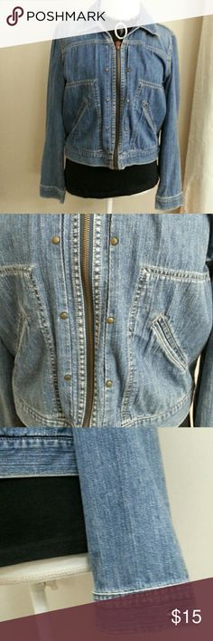 """Tommy Hilfiger Jean Jacket Cute medium wash jacket with little bronze colored studs along zipper. Gently worn with one little frayed spot (last photo) It is 100% cotton and is unlined with simple hand pockets on each side. 20"""" length/ 24""""sleeve/ 18"""" bust Tommy Hilfiger Jackets & Coats Jean Jackets"""