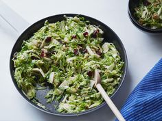 Crunchy-Sweet Brussels Sprout Salad : Instead of serving the Brussels sprouts whole this year, try them shredded and tossed with crunchy chopped walnuts and sweet dried cranberries in Sunny Anderson's 18-minute side salad. Using a mandoline to shred the sprouts will save you even more time.
