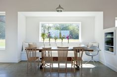 Like the concrete floor, base board, paint, dining table.