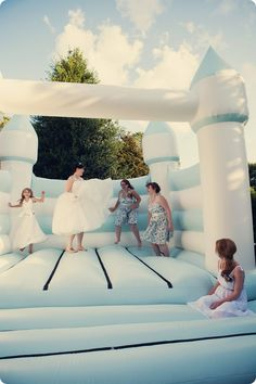 What kind of childhood whimsy themed wedding would it be without a bouncy castle?!