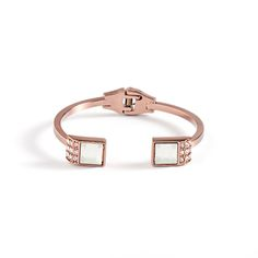 """Love this! Found it on Journey Accessories Warm toned and sleek, mocha metals are more on-trend than ever. Tonya is a shimmering example of this sleek look. This open bangle features opal glass stone and triple rows of CZ's for added sparkle. The stackable elegant Tonya is both modern and timeless.  - Mocha metal, opal glass stones, clear CZ's - 1/2"""" wide at center - 2 x 2 1/2"""" interior diameter - Hinged bangle $52"""