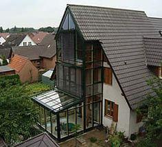 sichtschutz und sonnenschutz f r den wintergarten mit lamellenvorh ngen wintergarten. Black Bedroom Furniture Sets. Home Design Ideas
