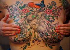 Beautiful tattoo -- great idea for covering for mastectomy scars. [p-ink.org]
