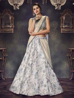 09e60d020 Intriguing grey and cream net ceremonial wear bollywood style lehenga choli.  Having fabric net