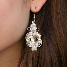 Fair Trade Knot Earrings — handmade in India — These stunning earrings feature a looped knot of silver-colored brass wire.