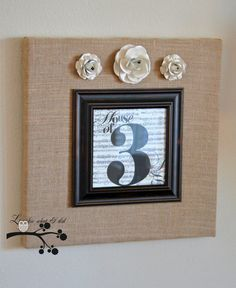 burlap around canvas with smaller frame attached to front.