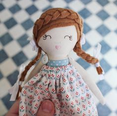 Maggie is about 24 cms (9.5 in) tall. Her body is double lined and double stitched for durability. Her face is hand embroidered and therefore uniquely one of a kind. Her arms are button jointed. Her dress is removable.  Maggie is suggested for gentle play by children over 3. Adult supervision is recommended as she has small parts.  Maggie is an original design from A Few Lovely Things. All dolls are made to the highest standards.  Copyright A Few Lovely Things 2017  Thanks a mil