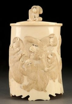 A VERY FINE JAPANESE CARVED IVORY LIDDED POT, PROBABLY MEIJI PERIOD. Of natural cylindrical form, finely carved in good relief with 15 well animated monkeys in good detail with realistic fur, the cover terminating with a figural monkey handle. Height 9 inches (23 cm).