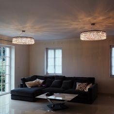 The living room is a multi-functional room in every apartment or house. Chandeliers should contribute to this and integrate flexible in every situation. Modern LED lamps which can be controlled via an app (Casambi) can dim the light level and generate the perfect ambience for every time of day.  #dotzauer #manufaktur #kristallleuchte #kronleuchter #kristall #inlovewithlight #crystalchandelier #lighting #bespoke #interiordesign #wohnzimmer #livingroom #family #swarovski #crystallized Led Lamp, Lamps, Villa, Chandeliers, Bespoke, Beautiful Places, Swarovski, Couch, Ceiling Lights