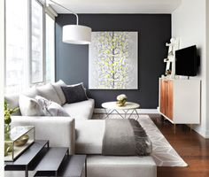 Charcoal accent wall with lime green, geometric area rug