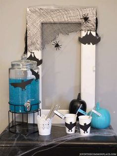Do you love the bright colors for Halloween? Host a modern kids' Halloween party with aqua and black party decorations. Discover easy diy party decorations, DIY surprise ball party favors, simple snacks and more! Halloween Party Favors, Halloween Cocktails, Halloween Treats, Modern Halloween, Family Halloween, Diy Party Decorations, Halloween Decorations, Modern Kids, Halloween Activities