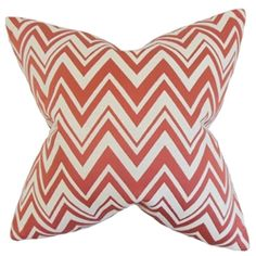 """This versatile throw pillow brings a modern touch to your interiors with its bold zigzag pattern. In red and white hues, this square pillow is ideal for your living room and bedroom. It works well with solid color pillows and other patterns. This 18"""" pillow is made of a blend of materials: 72% cotton and 28% polyester. $55.00  #zigzag  #pillows  #homedecor  #interiorstyling  #throwpillow"""