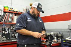 Nos. 48/88 mechanic Rich Gutierrez working hard in the shop on April 9.
