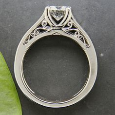 Delicate filligree on the sideface of a mounting, especially those of platinum, helps to light the piece and add interest overall...