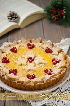 Crostata all'arancia e cannella una ricetta facile da preparare, una crostata natalizia bella da vedere e buonissima.Ottima per colazione e come fine pasto.
